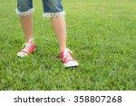 girl teen walk on grass with... | Shutterstock . vector #358807268