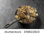 Iron Pan And Short Necked Clam...