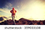 young woman backpacker hiking... | Shutterstock . vector #359033108