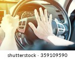 man driving a car with hand on... | Shutterstock . vector #359109590