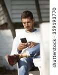 young handsome man using mobile ...   Shutterstock . vector #359193770