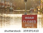A \'road Closed\' Sign Partially...