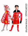Small photo of young boy and girl in medieval carnival costume, red caftan, cocked hat, tricorn red and white fluffy skirt