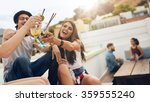 happy young people toasting...   Shutterstock . vector #359555240