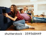 shot of a woman watching funny... | Shutterstock . vector #359568449