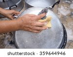 scrubbing pot with scour pad... | Shutterstock . vector #359644946