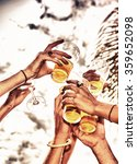 closeup of hands toasting with... | Shutterstock . vector #359652098