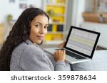 woman using her notebook at... | Shutterstock . vector #359878634