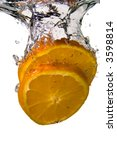 Two slices of orange bursting into cool water - stock photo
