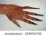 Small photo of BALI, INDONESIA - January 9, 2016: A traditional Balinese dancer displays his abnormally long, natural, 2 1/2-year-old fingernails on January 9, 2016 in Kintamani, Bali, Indonesia.
