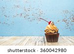 chocolate cupcakes on wood... | Shutterstock . vector #360042980