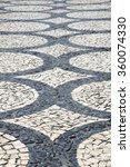 Small photo of Cobblestones arranged in circles (public space) Handmade pavement (Calçada Portuguesa) in Porto, Portugal.