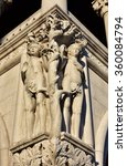 Small photo of Adam and Eve sculptures at the corner of Doge Palace in Saint Mark Square, Venice