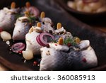 Stock photo rolled herring in vinegar served with onions and pickles perfect for vodka 360085913