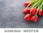 Red Tulips On A Wooden...