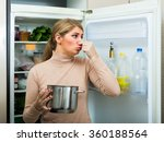 young woman smelling foul smell ... | Shutterstock . vector #360188564