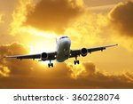 airplane landing over clouds at ... | Shutterstock . vector #360228074