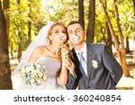 Wedding Couple Posing With...