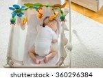 baby sleeping in crib | Shutterstock . vector #360296384