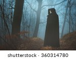Black Hooded Person In A Foggy...