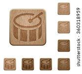 set of carved wooden drum...