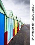 Small photo of Colourful Beach Huts on Dull, Drab, Cloudy Winters Day in Brighton, West Sussex, England, UK