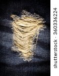 Small photo of Vintage Laceration of jeans.
