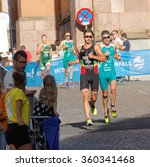 Small photo of STOCKHOLM, SWEDEN - AUG 23, 2015: Tough fight betwwen two running triathletes Pereira and Bailie in the Men's ITU World Triathlon series event August 23, 2015 in Stockholm, Sweden