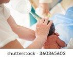 newborn baby first bath | Shutterstock . vector #360365603