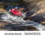 Girl Alone Rafting On The Rive...