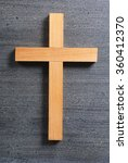 wooden cross on rusty black... | Shutterstock . vector #360412370