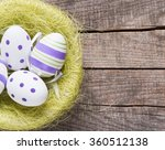easter eggs on wooden background | Shutterstock . vector #360512138