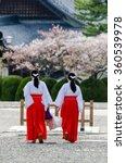 Two Women Monks Walk Around...