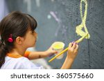 Artistic Kid Painting Mural