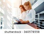 couple of a businesswomen... | Shutterstock . vector #360578558