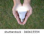 Led Bulb With Lighting On Hand...