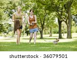 young women walking dog at a... | Shutterstock . vector #36079501
