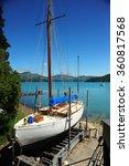 Small photo of Akaroa,New Zealand - on December 21st, 2011:A boat in harbour of Akaroa,New Zealand