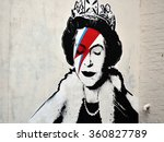 Small photo of BRISTOL, UK - AUG 21, 2015: View of a Banksy piece depicting the Queen as David Bowie in his Ziggy Stardust persona seen on a city centre street. Banksy is a world renowned street artist from Bristol.