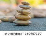 placing the stone stack on a... | Shutterstock . vector #360907190