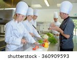 chef watching trainees at work | Shutterstock . vector #360909593