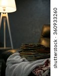 pile of books on leather chair... | Shutterstock . vector #360933260