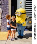 Small photo of LOS ANGELES, USA - SEP 27, 2015: Unidentified kids with Minion at the Hollywood Universal Studios. Minions is a 2015 American 3D computer-animated family film