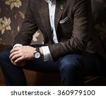 man sitting with his hands... | Shutterstock . vector #360979100
