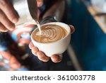 cup of coffee latte art in... | Shutterstock . vector #361003778