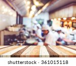 empty wood table with blur open ... | Shutterstock . vector #361015118