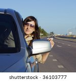 happy young brunette driving... | Shutterstock . vector #36103777