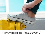 person putting on pair of shoes.... | Shutterstock . vector #361039340
