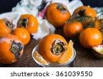 fresh fruits on a wooden... | Shutterstock . vector #361039550