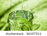pouring water in full glass on... | Shutterstock . vector #36107311